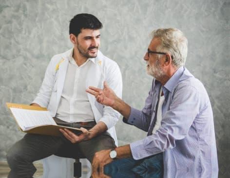 senior man and a man talking